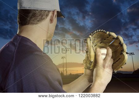 Baseball pitcher ready to pitch in an evening baseball game