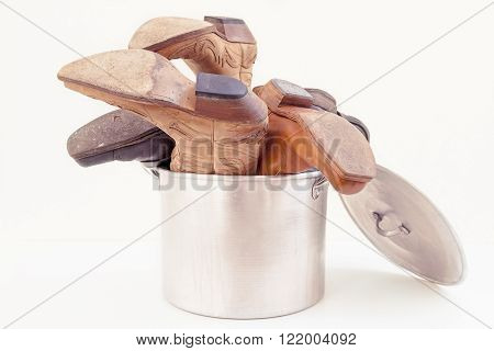 vintage cowboy boots inside a kitchen pot