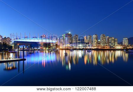 Vancouver City skyline and BC Place Stadium at night, Vancouver, British Columbia, Canada.