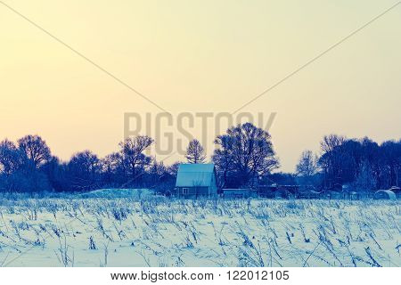 House In The Village In The Winter