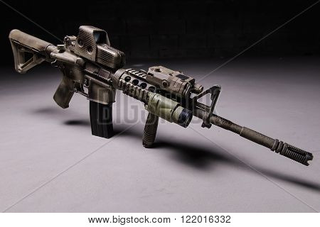 Assault rifle with camouflage patternoptical and laser sight