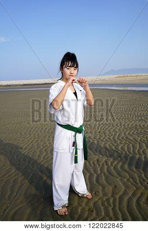 KAGAWA, JAPAN - Jan 3: Japanese karate boys and girls of fighting-pose in midwinter at Ichinomiya Beach, January 3, 2016, Kagawa, Japan