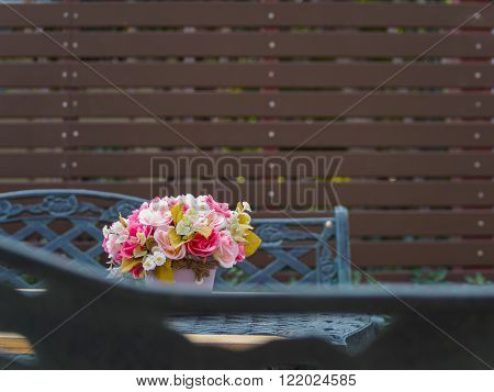 Flowerpot on vintage table and bench in outdoor garden and battens background, Copy Space, Vintage