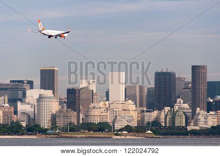 Rio de Janeiro, Brazil - February 26, 2016: GOL Airlines aircraft preparing for landing in Santos Dumont airport. City downtown in background.