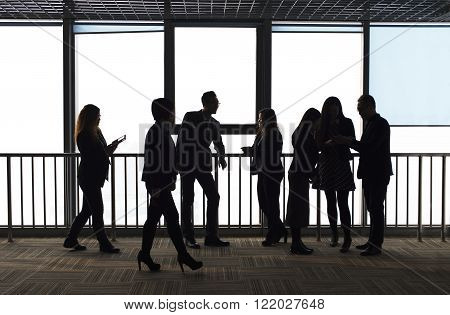 group of people in front of city window