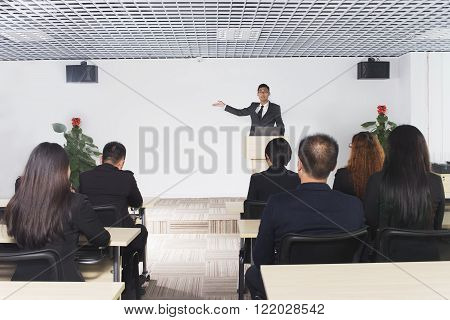business man giving a conference in a room