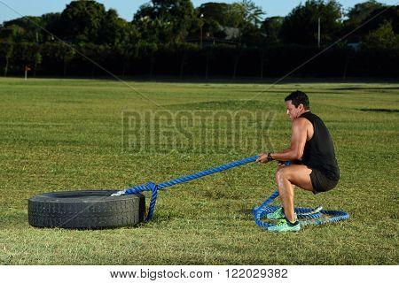 Man Pull Tire