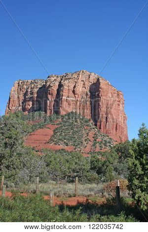 Courthouse Butte in Sedona, Arizona against a clear blue sky