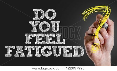 Hand writing the text: Do You Feel Fatigued?