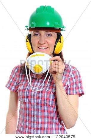 Smiling female construction worker with protective mask wearing green helmet and protective headphones safety at work and ear protection. White background