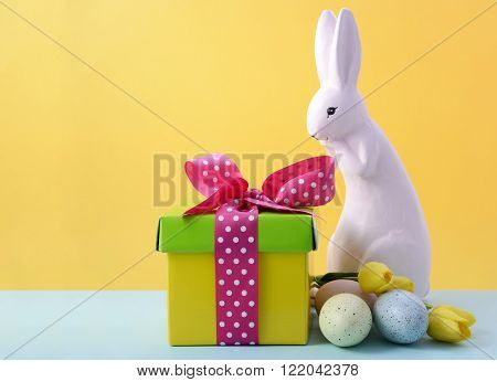 Cute Easter Bunny With Yellow Background.