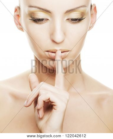 girl with finger over her mouth