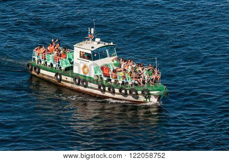 Valparaiso Chile - December 3 2012: Unidentified tourists aboard a boat in the Bay of Valparaiso Chile.