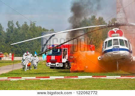 RUSSIA NOGINSK - AUGUST 7 2015: Demonstration performances of rescuers of Ministry of Emergency Situations of Russia. Fire extinguishing on aviation equipment.