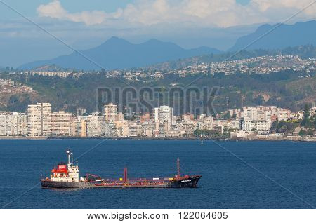 Valparaiso Chile - December 4 2012: Oil Products Tanker Dona Carmela on the background of Valparaiso Chile. Valparaiso use to be one of the most important ports in South America before the Panama canal.