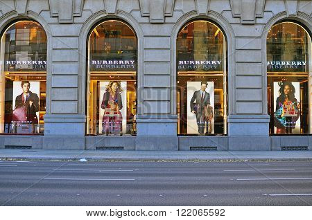 BARCELONA SPAIN - DECEMBER 9 2014: Facade of Burberry flagship store in the street of Barcelona on December 9 2014. Burberry is a luxurious clothing brand based in Great Britian.