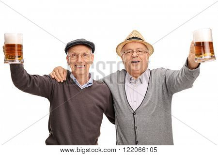 Studio shot of two cheerful seniors holding pints of beer and celebrating isolated on white background