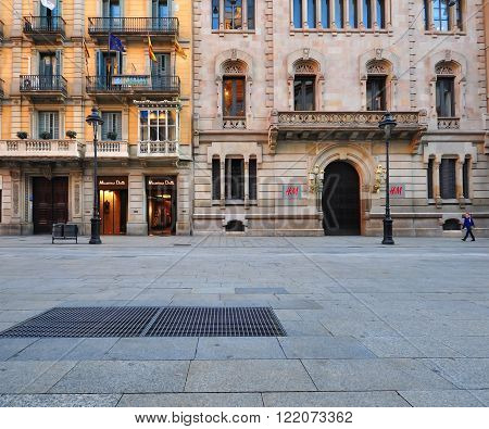 BARCELONA SPAIN - JANUARY 17: View of the Rambla street Barcelona on January 17 2015. Barcelona is the capital of Catalonia and second largest city of Spain.