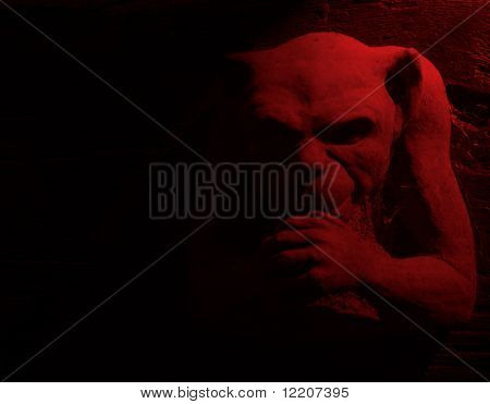 Gargoyle figure with red lighting effect