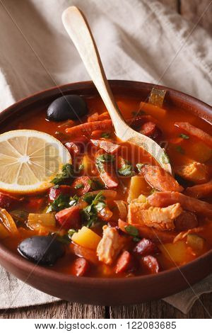 Tasty Soup With Meat And Sausages Solyanka Close Up In A Bowl. Vertical