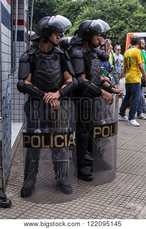 Sao Paulo Brazil March 13 2016: A couple of unidentified police officers in the biggest protest against federal government corruption in Sao Paulo Brazil.
