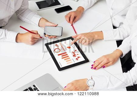 Business women using tablet computer in meeting