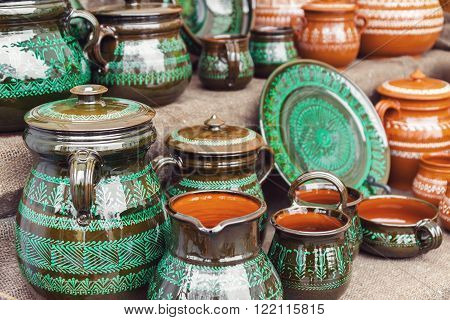 Group of traditional handmade pottery for sale at the market