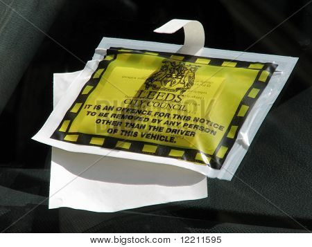 Parking ticket on parked vehicle in Leeds, West Yorkshire, UK