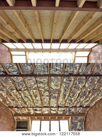Fiberglass batt insulation between roof trusses at a house construction site