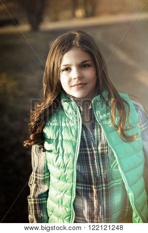 Cute fun and stylish caucasian tween girl outside