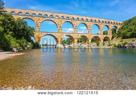 Aqueduct Pont du Gard - the highest in Europe. The bridge was built on the river Gardon in Provence. France, spring sunny day