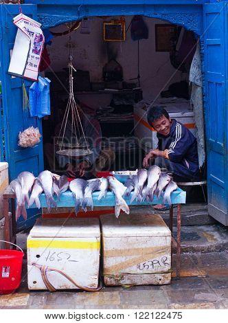 KATHMANDU NEPAL - MARCH 23: Street trade of the fish march 23 2014 in Kathmandu Nepal.