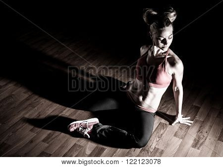 Photo of Beautiful young woman in a gym