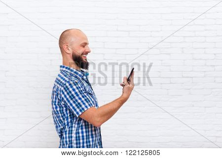 Casual Bearded Man Using Cell Smart Phone Smile Standing Profile Looking Side