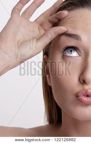Closeup Of Beautiful Model Applying Her Skin Treatment