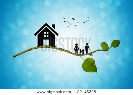 Tree branch with silhouettes of house and family. The concept of a happy family. Eco life