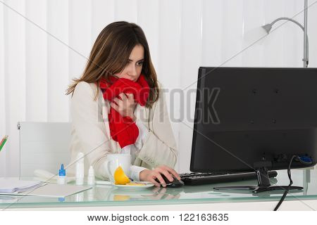 Sick Young Businesswoman Working On Computer In Office