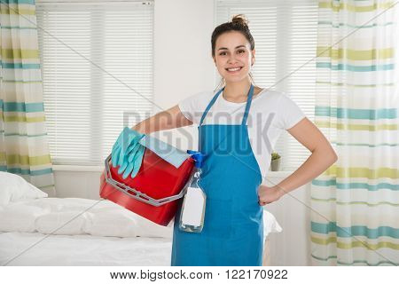 Female Housekeeper With Cleaning Equipment
