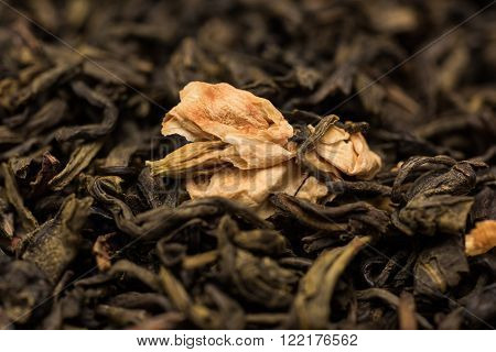 Dry green tea with jasmine extreme close-up background