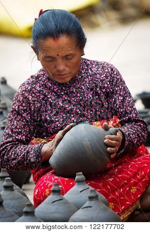 Nepalese Woman Working In The Her Pottery Workshop