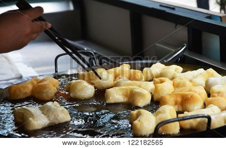 chinese donut fry until golden, In Thailand, youtiao or
