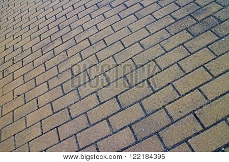 Full frame brick pavement close up from skewed low tilted angle in horizontal 3:2 format.