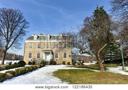 Historic Georgian 1748 Van Cortlandt Manor House built in dressed fieldstone with a double-hipped roof in Bronx New York