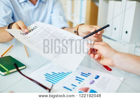 Business people concluding a deal and signing a contract