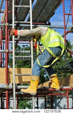 SELANGOR, MALAYSIA - FEBRUARY 23, 2016: Construction workers wearing safety harness and working at high level at the construction site in Selangor, Malaysia.