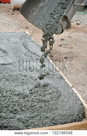 MALACCA, MALAYSIA - FEBRUARY 05, 2016: Fresh liquid concrete is poured on top slab formwork form a solid concrete slab when it has been hard.