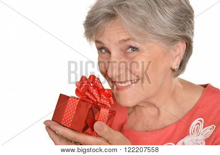 Portrait an older woman with a red gift on a white background.