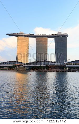 Singapore, Singapore - May 17, 2015: The hotel Marina Bay Sands at the Marina Bay in Singapore at sunset. Its a luxury resort famous for its casino and infinity swimming pool. The hotel is one of the landmarks and tourist attractions in Singapore.