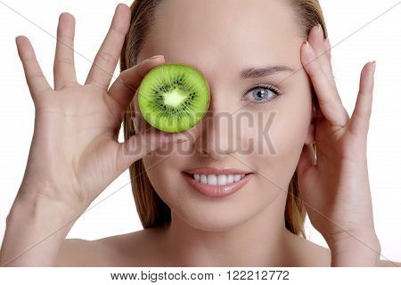 Young Happy Woman Holding A Fresh Kiwi