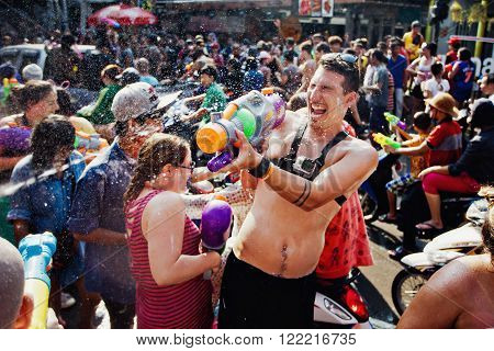 KO SAMUI, THAILAND - APRIL 13: Unidentified tourists in a water fight festival or Songkran Festival (Thai New Year) on April 13, 2014 in Chaweng Main Road, Ko Samui island, Thailand.
